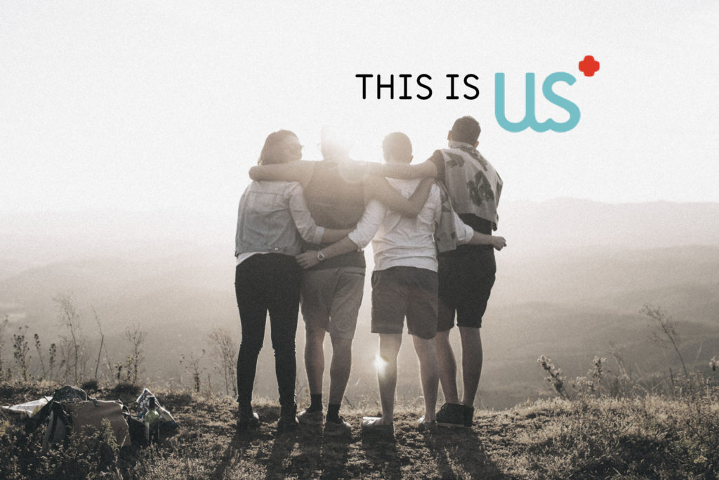 Image: Group of people enjoying a sunrise, with arms around eachother Text: This is us
